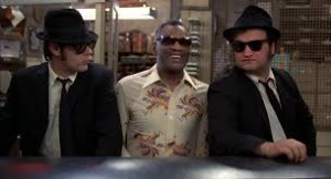 The Blues Brothers is not just a series of blues covers held together with F-bombs and pratfalls, although all those elements do help.
