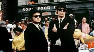 The Blues Brothers doesn't have the romantic tension and chemistry that Fred Astaire and Ginger Rogers delivered in classic Hollywood musicals like Top Hat; instead, you have the foul-mouthed banter of brothers Jake and Elwood shuffling and somersaulting their way into our hearts for the unapologetic antiheroes they are.